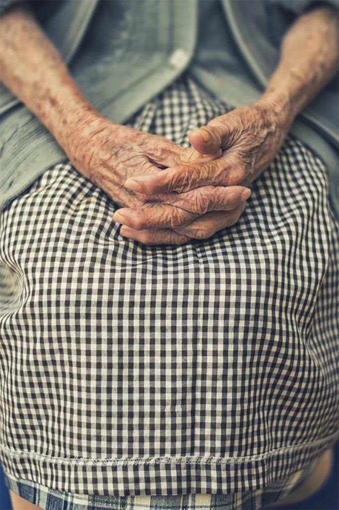 close up of old woman's gnarled hands